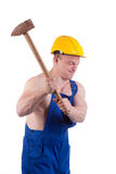 Muscular worker. With big  hammer Stock Photo