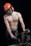 Muscular worker with helmet Stock Photo