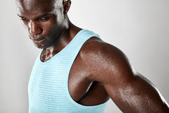 Muscular young african man looking down Royalty Free Stock Photos