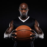 Muscular young basketball player with a ball Royalty Free Stock Image