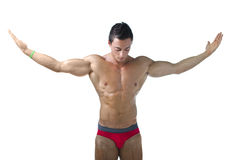 Muscular young bodybuilder with arms spread open Stock Images