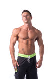 Muscular young bodybuilder in relaxed pose Stock Photos