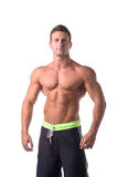 Muscular young bodybuilder in relaxed pose Stock Images