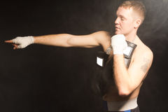 Muscular young boxer pointing his hand Royalty Free Stock Photo