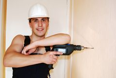 Muscular young builder. Stock Photos