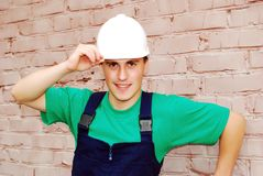 Muscular young builder. Royalty Free Stock Images