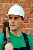 Muscular young builder. Royalty Free Stock Image