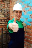 Muscular young builder. royalty free stock photography