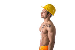 Muscular young construction worker shirtless Stock Images