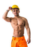 Muscular young construction worker shirtless smiling stock photography