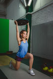 Muscular young fitness woman lifting a weight crossfit in the gym. Crossfit. Woman. Crossfit style Stock Photos