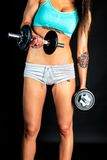 Muscular young girl with dumbbells Royalty Free Stock Photos