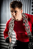 Muscular young guy with chain Royalty Free Stock Photography