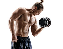 Muscular young guy doing exercises with dumbbells at biceps. Photo of sporty male with naked torso on white background. Strength and motivation stock photos