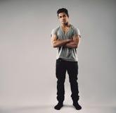 Muscular young guy posing confidently Stock Photos