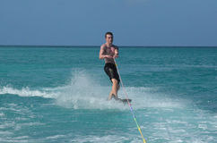 Muscular Young Guy Riding a Wakeboard in Aruba Royalty Free Stock Photos