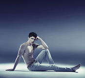 Muscular young guy in sexy pose Royalty Free Stock Images