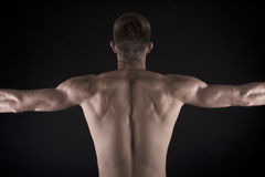 Muscular young male body on black background Stock Photo