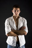 Muscular young male body on black background Royalty Free Stock Photography