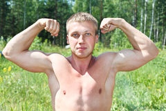 Muscular young man Stock Photos