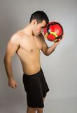 Muscular young man with balloon Stock Photography