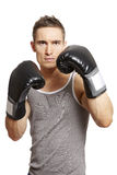 Muscular young man boxing in sports outfit Stock Image