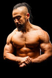 Muscular Young Man in Contrast Light Royalty Free Stock Photography