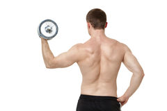 Muscular young man exercising with dumbbell. Royalty Free Stock Photos