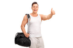 Muscular young man giving a thumb up Royalty Free Stock Image