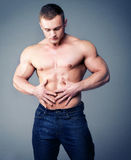Muscular young man in jeans. Stock Photos