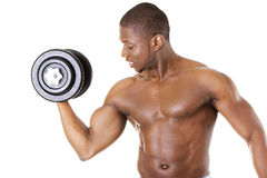 Muscular young man lifting weights Royalty Free Stock Photo