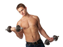 Muscular young man lifting weights Royalty Free Stock Images