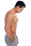 Muscular young man looking down abs bodybuilder bodybuilding mus Stock Photography