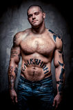 Muscular young man with many tattoos Royalty Free Stock Image