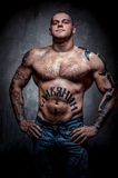 Muscular young man with many tattoos Stock Photo