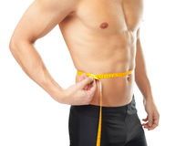 Muscular young man measuring waist. Isolated on white background. Male torso Royalty Free Stock Images