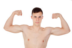 Muscular young man with naked torso. On white background Royalty Free Stock Images