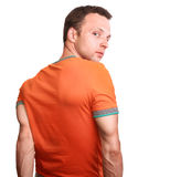 Muscular young man in orange t-shirt Royalty Free Stock Photography