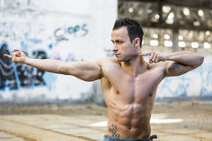 Muscular young man pointing with fingers Stock Photography