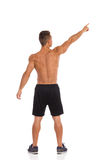Muscular Young Man Pointing Up. Rear view. Stock Photography
