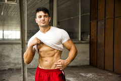 Muscular young man portrait indoors Royalty Free Stock Photos