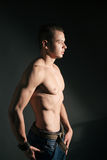 Muscular young man Stock Photography