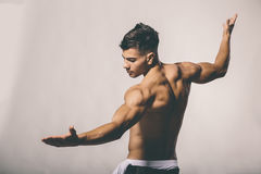 Muscular young man posing in the studio Stock Images