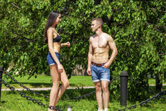 Muscular young man and sexy naked woman Royalty Free Stock Photos