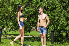 Muscular young man and sexy naked woman Royalty Free Stock Image