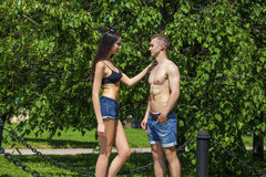 Muscular young man and sexy naked woman Stock Photography