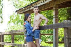 Muscular young man and sexy naked woman Stock Photo