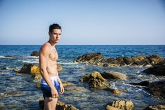 Muscular young man shirtless against the sky Stock Photos