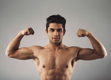 Muscular young man showing off his defined body Stock Photos