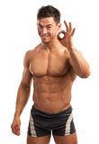Muscular young man showing the ok sign Royalty Free Stock Image